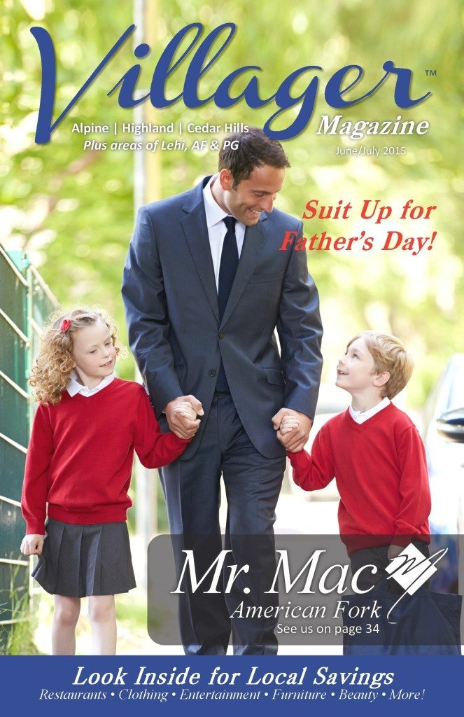 Image of a Villager Magazine cover with a father wearing a suit from Mr. Mac and two children.