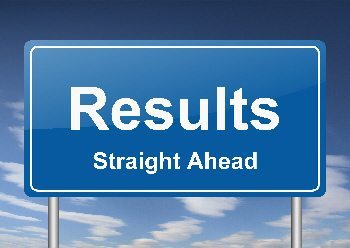 """Image of a sign stating """"Results Straight Ahead""""."""